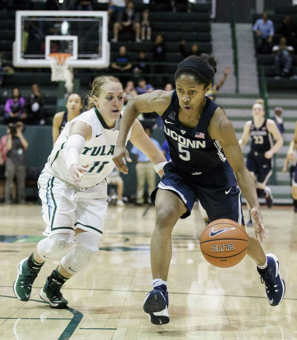 Tulane guard (11) runs after UConn guard Crystal Dangerfield drives on Tulane's Leslie Vorpahl during a Feb. 18 game in New Orleans.