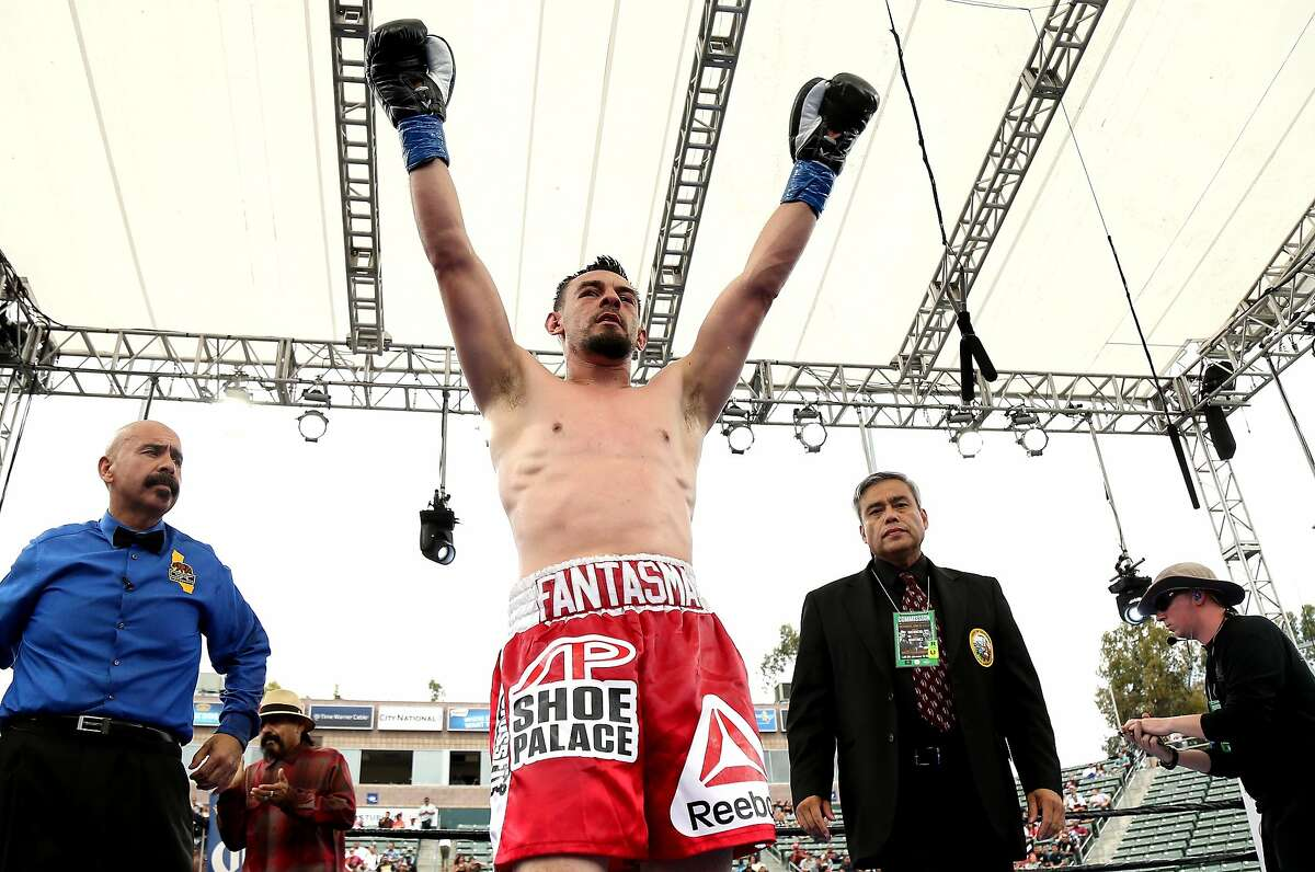 CARSON, CA - JUNE 06: Robert Guerrero celebrates after the final bell against Aron Martinez in their welterweight bout at StubHub Center on June 6, 2015 in Carson, California. Guerrero won in a split decision. (Photo by Stephen Dunn/Getty Images)