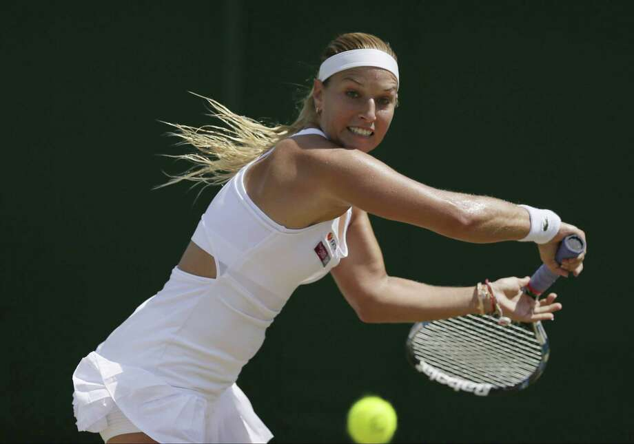 Slovakia's Dominika Cibulkova returns to Croatia' Ana Konjuh during their women's singles match at Wimbledon on July 7 in London. Photo: Tim Ireland / Associated Press / Copyright 2017 The Associated Press. All rights reserved.
