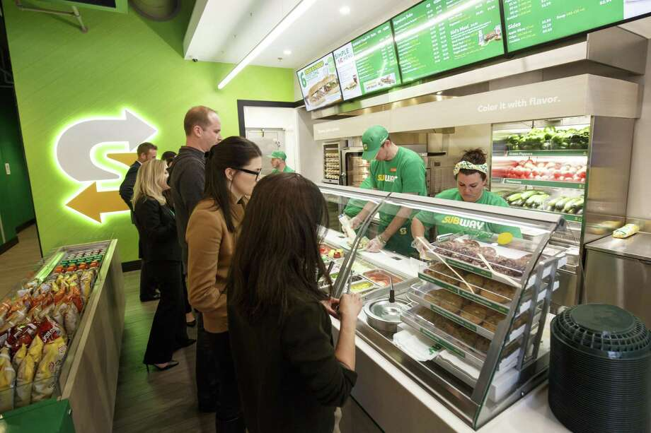 This January 2017 photo provided by Subway shows the interior of a remodeled Subway store in Knoxville, Tenn. Subway is looking to update the look of its stores as the chain's U.S. sales have been declining. The company says the redesign, which includes a brighter atmosphere, displays of vegetables behind the counter and ordering tablets, is the first major revamp since the early 2000s. (Chris Radcliffe/Subway via AP) Photo: Chris Radcliffe, HONS / Associated Press / Subway