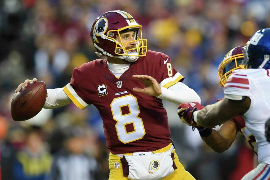 FILE - In this Jan. 1, 2017 file photo, Washington Redskins quarterback Kirk Cousins (8) passes during the first half of an NFL football game against the New York Giants in Landover, Md. In a move that seemed the most likely at this point in the odd dance between Kirk Cousins and the Washington Redskins, the team placed the exclusive franchise tag on the starting quarterback on Tuesday. (AP Photo/Nick Wass, File) Photo: Nick Wass, FRE / FR67404 AP
