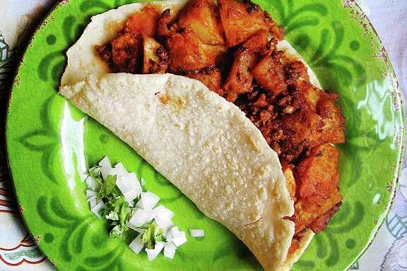 Chorizo and potato taco on a handmade corn tortilla from Southside Cardinal Cafe.