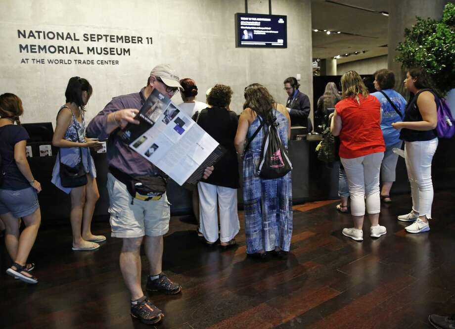 """Visitors to the National September 11 Memorial and Museum pick up maps and guides in New York. Last winter the U.S. tourism industry worried about a """"Trump slump,"""" fearing that Trump administration policies might discourage international travelers from visiting the U.S. But statistics from the first half of 2017 suggest that the travel to the U.S. is robust. Photo: Kathy Willens /Associated Press / Copyright 2017 The Associated Press. All rights reserved."""