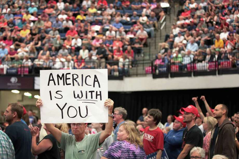 Guests listen as President Donald Trump speaks at a rally on June 21 in Cedar Rapids, Iowa. Trump is turning his focus back to trade this week. Photo: Scott Olson /Getty Images / 2017 Getty Images