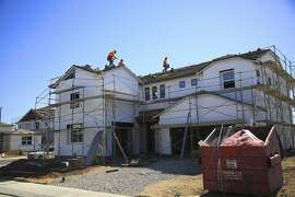 Houses under construction in Manteca, Calif., June 27, 2017. A full-fledged housing crisis has gripped California, where the lack of affordable homes and apartments for middle-class families is severe. The median cost of a home here is now a staggering $500,000, twice the national cost. Homelessness is surging across the state. (Jim Wilson/The New York Times)