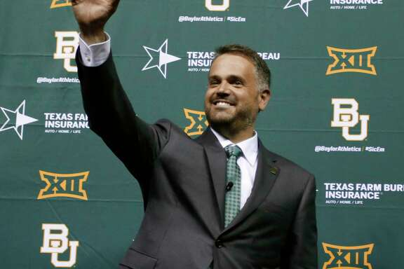 Matt Rhule is introduced as Baylor University's new football coach during a public event at the Ferrell Center, Wednesday, Dec. 7, 2016, in Waco, Texas. Rhule replaces Jim Grobe, who led the Bears to a 6-6 record as interim coach this season after Art Briles was fired May 26. (Rod Aydelotte/Waco Tribune Herald via AP)
