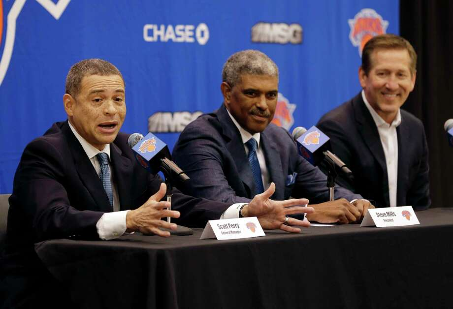 New York Knicks general manager Scott Perry, left, speaks while president Steve Mills, center, and head coach Jeff Hornacek listen during a news conference in in Greenburgh, N.Y., Monday, July 17, 2017. (AP Photo/Seth Wenig) ORG XMIT: NYSW104 Photo: Seth Wenig / Copyright 2017 The Associated Press. All rights reserved.
