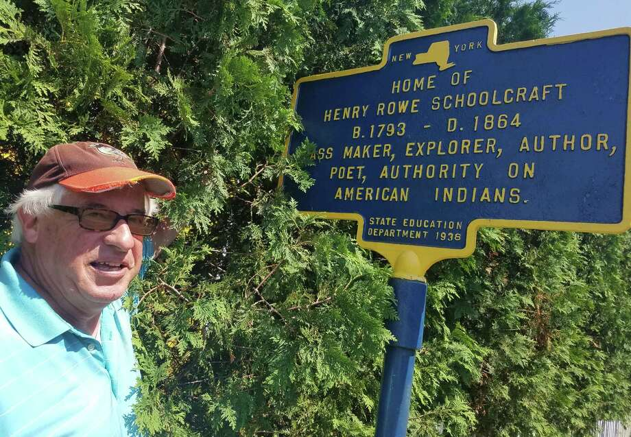 Guilderland resident John Haluska stands with a historical marker he painted along Willow Street. (Chris Churchill / Times Union)