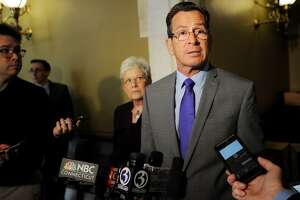 Flanked by Lt. Gov. Nancy Wyman, left, Gov. Dannel P. Malloy speaks to the media after meeting with senate and house leaders in budget negotiations at the Capitol in Hartford, Conn. on Thursday, June 1, 2017.