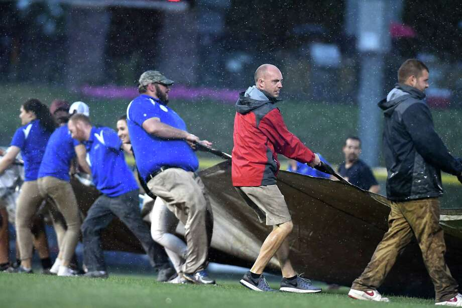 Tri-City ValleyCats ground crew cover the field with tarp after heavy rain falls during a baseball game against the Connecticut Tigers at Joe Bruno Stadium on Monday, July 17, 2017 in Troy, N.Y. The game was postponed until tomorrow night. (Lori Van Buren / Times Union) Photo: Lori Van Buren / 40040770A
