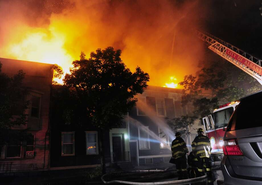 Albany firefighters battle a massive blaze on Madison Avenue where five or six row houses are in flames near Lark Street on Monday, July 17, 2017. (Robert Downen/Times Union)