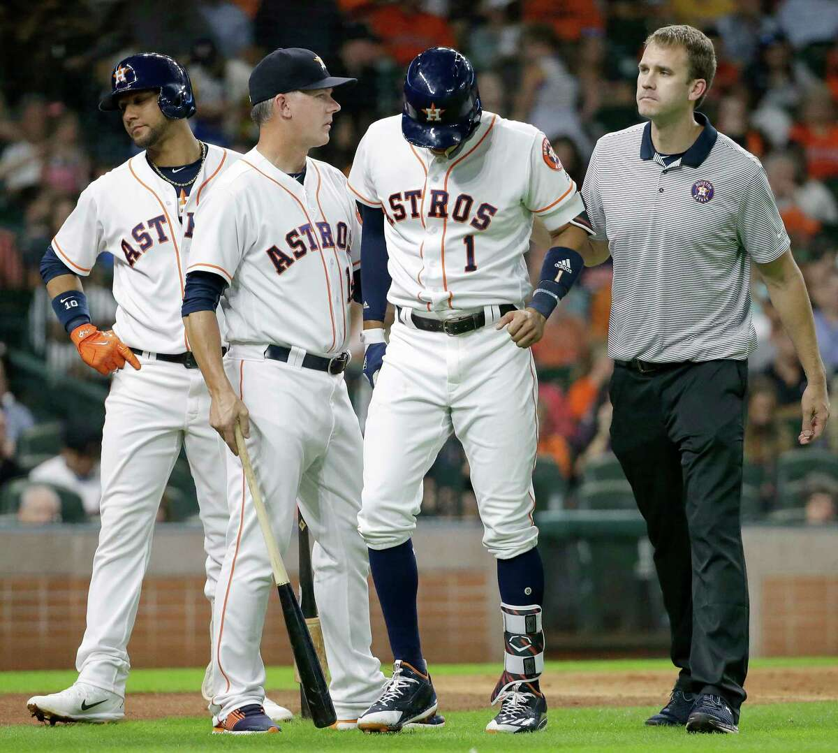 PHOTOS: Notable injuries in Houston sports history Houston Astros Yuli Gurriel, left, waits as Carlos Correa leaves the field with manager A.J. Hinch and trainer Jeremiah Randall, right, during the fourth inning after injuring it at bat against the Seattle Mariners at Minute Maid Park on July 17, 2017 in Houston, Texas. Correa left the game. Browse through the photos above for a look back at notable injuries in the history of Houston sports.
