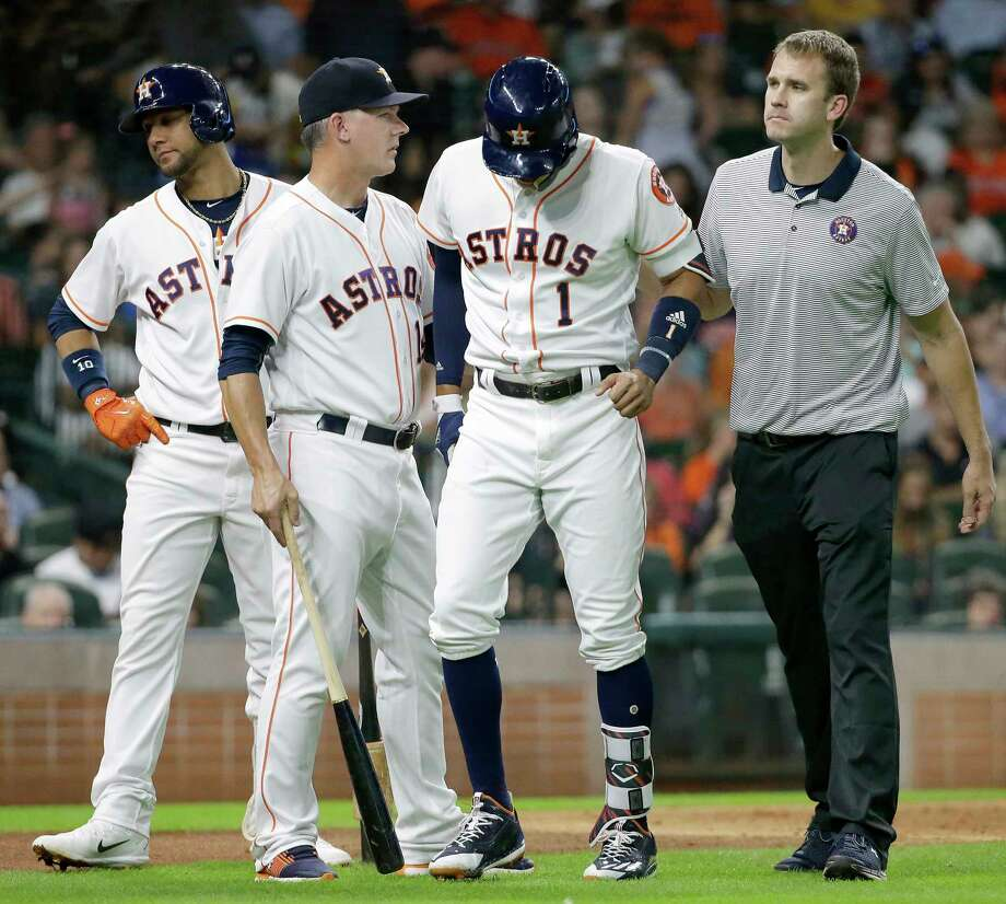 PHOTOS: Notable injuries in Houston sports historyHouston Astros Yuli Gurriel, left, waits as Carlos Correa leaves the field with manager A.J. Hinch and trainer Jeremiah Randall, right, during the fourth inning after injuring it at bat against the Seattle Mariners at Minute Maid Park on July 17, 2017 in Houston, Texas. Correa left the game.Browse through the photos above for a look back at notable injuries in the history of Houston sports. Photo: Melissa Phillip, Houston Chronicle / © 2017 Houston Chronicle