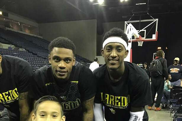 A Swarm fan poses with guards Kevin Jefferson Jr. and Anthony Alston after a game last year. Laredo is set to come back to Laredo Energy Arena for the 2017-18 campaign but still needs to work out some details with the arena and city.