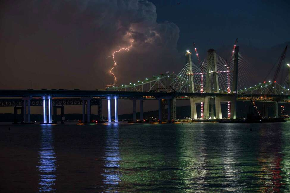 Lightning strikes over the new Tappan Zee Bridge as a storm rolls into Tarrytown, N.Y., May 31, 2017. Several months remain before it officially opens to long-expectant commuters, but you can now drive across the entire three-mile length of the new Tappan Zee Bridge, a critical crossing in the suburbs of New York City. (Fred R. Conrad/The New York Times) ORG XMIT: XNYT138