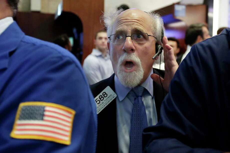 Trader Peter Tuchman works on the floor of the New York Stock Exchange, Monday, July 17, 2017. Stocks are starting the week mostly lower, having closed at all-time highs the week before. (AP Photo/Richard Drew) Photo: Richard Drew, STF / AP