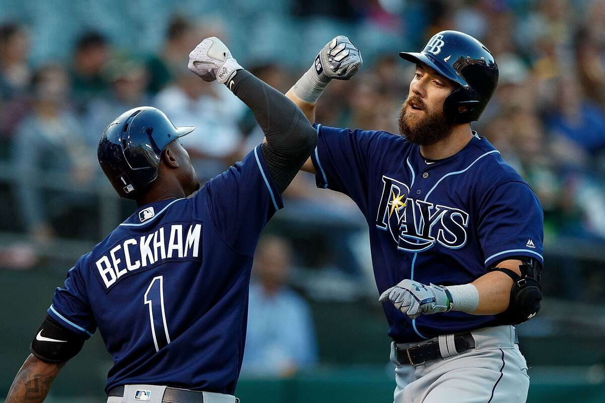 OAKLAND, CA - JULY 17: Steven Souza Jr. #20 of the Tampa Bay Rays celebrates with Tim Beckham #1 after hitting a home run against the Oakland Athletics during the second inning at the Oakland Coliseum on July 17, 2017 in Oakland, California. (Photo by Jason O. Watson/Getty Images)