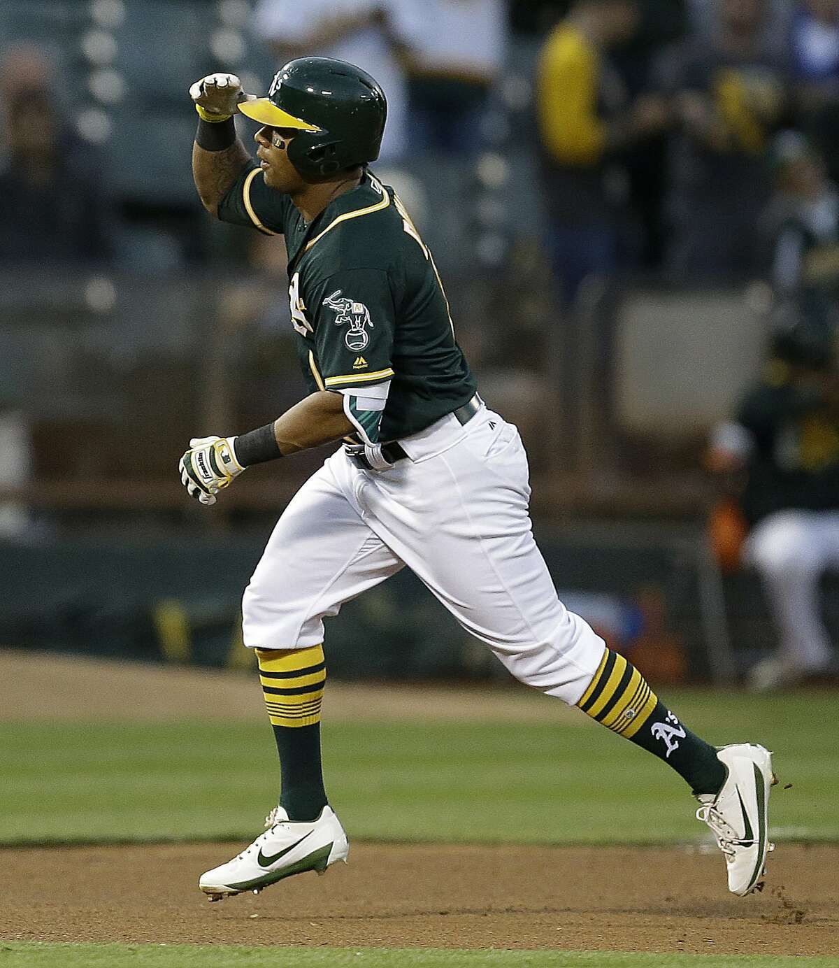 Oakland Athletics' Khris Davis celebrates after hitting a home run off Tampa Bay Rays' Jake Odorizzi during the fourth inning of a baseball game Monday, July 17, 2017, in Oakland, Calif. (AP Photo/Ben Margot)