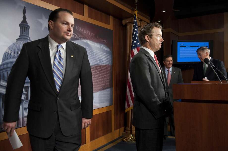 UNITED STATES – MARCH 15: From left, Sen. Mike Lee, R-Utah, Sen. Rand Paul, R-Ky., Sen. Jim DeMint, R-S.C., and Sen. Lindsey Graham, R-S.C. gather to hold a news conference in the Capitol to unveil a Medicare reform plan on Thursday, March 12, 2012. (Photo By Bill Clark/CQ Roll Call) Photo: Bill Clark/CQ-Roll Call, Inc.