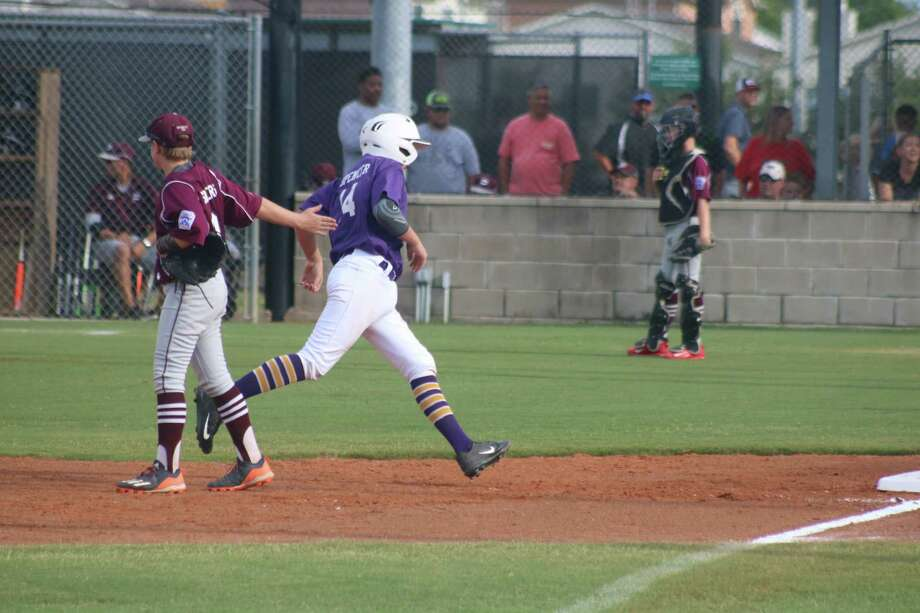 Pearland East  third baseman Rowdy Sowers extends a hand to Lufkin's Chandler Spencer as he rounds the bases following the first of his two homers Monday night. Spencer drove in four RBIs with his two clouts. Photo: Robert Avery