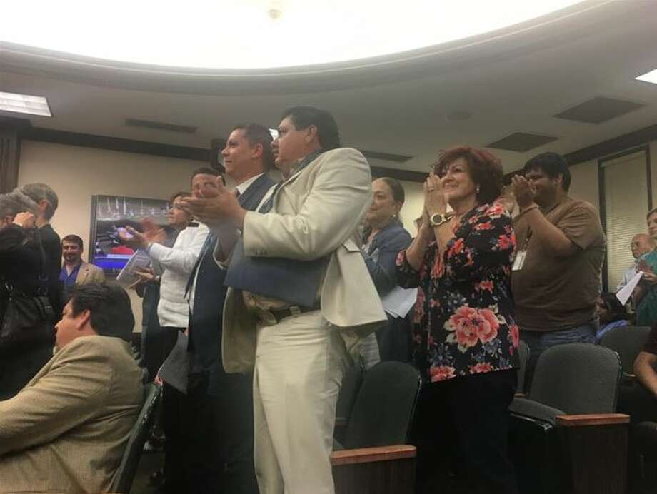 Those who attended the Laredo City Council meeting on Monday gave a standing ovation after it voted to join the lawsuit against Senate Bill 4.  Photo: Laredo Morning Times