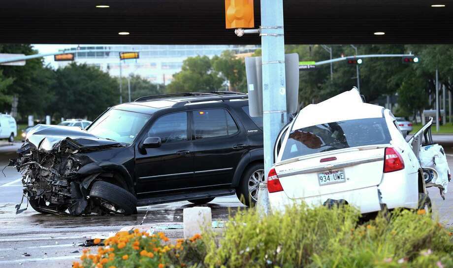 Houston police officers and firefighters responded to a two-vehicle accident at the intersection of West San Houston Parkway South and Richmond Avenue Tuesday, July 18, 2017, in Houston. Photo: Godofredo A. Vasquez / Houston Chronicle