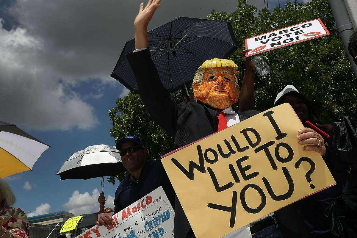 DORAL, FL - JUNE 28: Glenn Terry dressed as President Donald Trump joins with other protesters at U.S. Sen. Marco Rubio's (R-FL) office on June 28, 2017 in Doral, Florida. The protesters are demanding Rubio vote against the Senate health care proposal that would make drastic cuts to Medicaid and, according to the non-partisan Congressional Budget Office, make health insurance coverage unaffordable for millions. (Photo by Joe Raedle/Getty Images)
