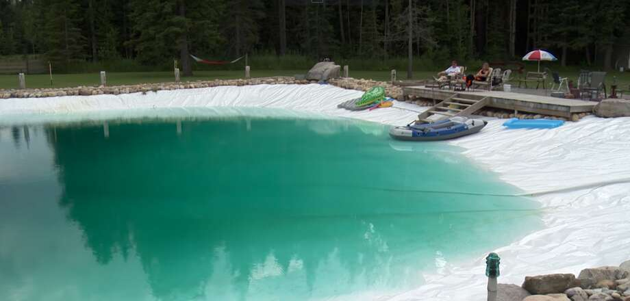 Man builds giant homemade swimming pool