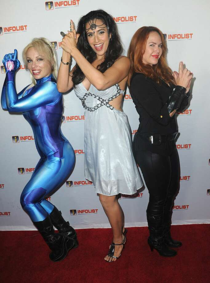 HOLLYWOOD, CA - JULY 13:  Cosplayers Vera Vanguard, Valerie Perez and actress Lisa Cash attend Jeff Gund's & INFOLIST.com's Annual Pre-Comic-Con Party held at OHM Nightclub on July 13, 2017 in Hollywood, California.  (Photo by Albert L. Ortega/Getty Images) Photo: Albert L. Ortega/Getty Images