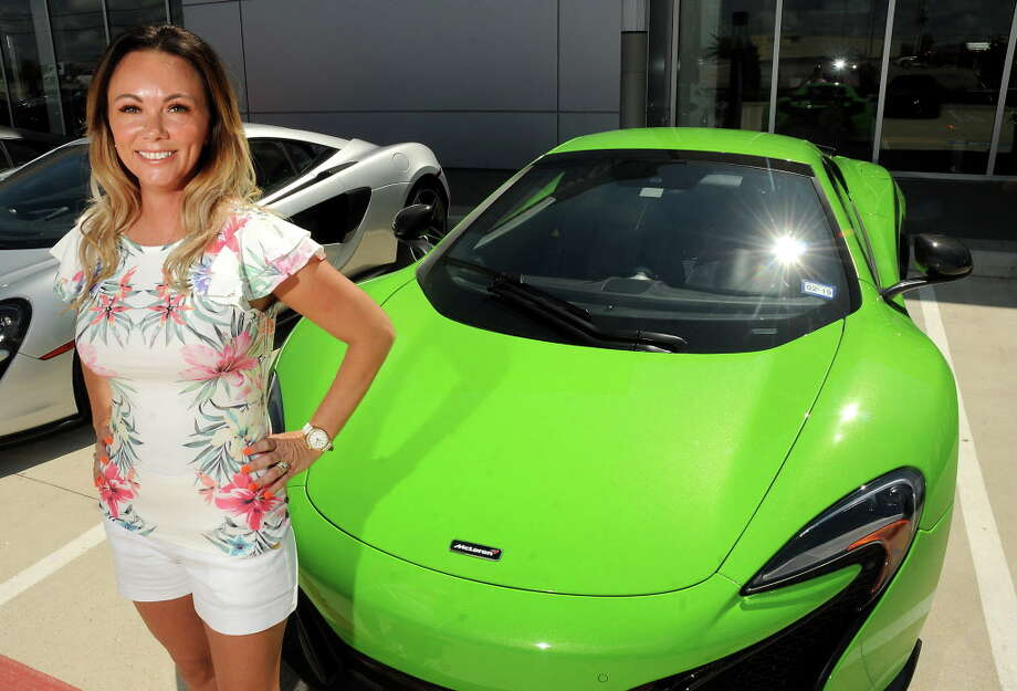 Heather Cline-Wehrly poses with her 650s at McLaren Houston on the North Freeway Friday July 14, 2017. Cline-Wehrly and other supercar owners headed to the Senna: Driving Instinct event at Circuit of the Americas in Austin.(Dave Rossman Photo) Photo: Dave Rossman, For The Chronicle / Dave Rossman