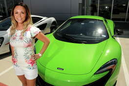 Heather Cline-Wehrly poses with her 650s at McLaren Houston on the North Freeway Friday July 14, 2017. Cline-Wehrly and other supercar owners headed to the Senna: Driving Instinct event at Circuit of the Americas in Austin.(Dave Rossman Photo)