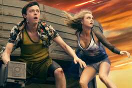 """This image released by STX Entertainment shows Dane DeHaan, left, and Cara Delevingne in a scene from """"Valerian and the City of a Thousand Planets."""" (Vikram Gounassegarin/STX Entertainment via AP)"""