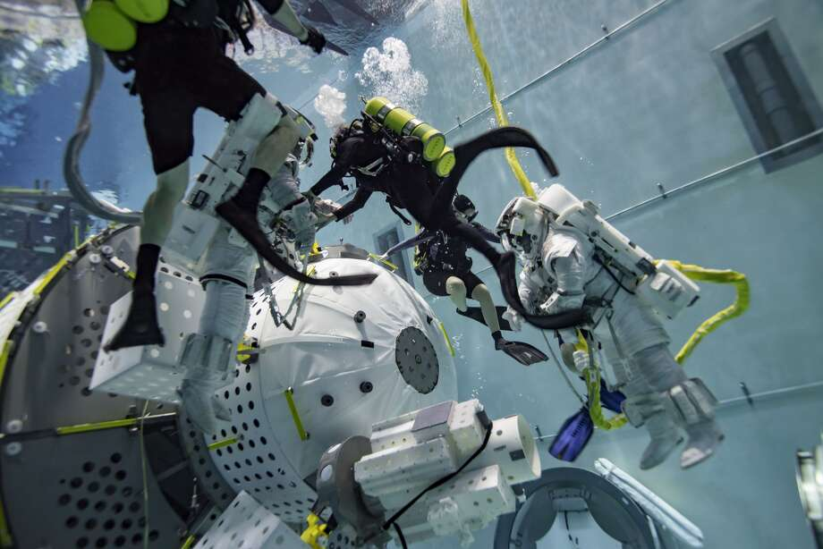 An air lock designed by Webster-based NanoRacks for the International Space Station passed an astronaut training exercise at Johnson Space Center's Neutral Buoyancy Laboratory.Continue for a look inside the NanoRacks office.