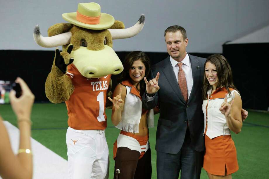 Texas head coach Tom Herman, second from right, poses for photos after speaking to reporters during the Big 12 NCAA college football media day in Frisco, Texas, Tuesday, July 18, 2017. (AP Photo/LM Otero) Photo: Associated Press / Copyright 2017 The Associated Press. All rights reserved.