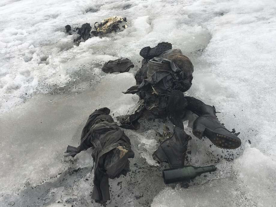 In this photo released by the Swiss train company ' Glacier 3000'  shoes and clothing are visible at a Swiss glacier where two bodies were found. . Police say the bodies of what appear to be two people killed in an accident decades ago have been recovered from a glacier in southwestern Switzerland. Valais canton police say the bodies were found on the Tsanfleuron glacier Friday  July 14, 2017 at an altitude of 2,615 meters (8,580 feet). They say the equipment found suggests that they died decades ago, and that formal identification with the help of DNA will take several days. (GLACIER 3000/Keystone via AP) Photo: Associated Press