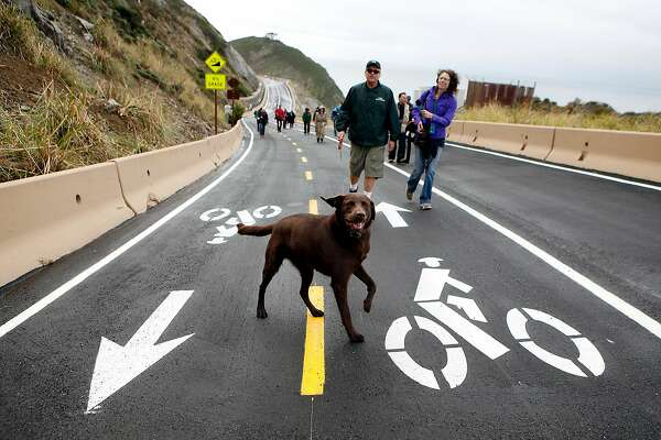 Park ambassador Don Traeger walks with his dog Maverick during a media tour of the newly completed Devil's Slide Costal Trail in Montara, CA, Tuesday Mar. 25, 2014.