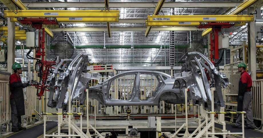 Workers assemble vehicles at the Nissan factory in Aguascalientes, Mexico in 2014. Recent reports show Mexico is quietly creating jobs at a record pace. Photo: McClatchy-Tribune News Service File Photo / McClatchy