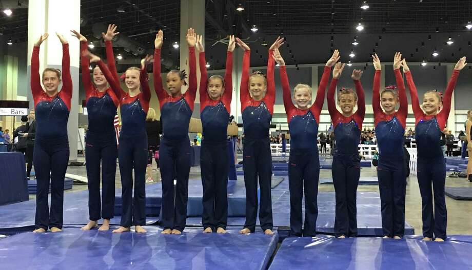 The Darien YMCA Level 7 National Champion team members were (L-R) Lana Schmidt, Holly McGoldrick (New Canaan), Paige Domenici, Leilani Nguyen, Bella DeStefano, Saskia Chermayeff, Kate Wolters, Tori Ware, Sofia DeStefano and Nadia Borja. Photo: Contributed Photo / Darien News contributed