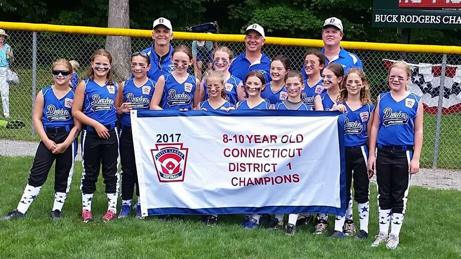 The Darien Little League 10U Softball District All-Stars won the Connecticut District I championship game Saturday over Wilton 10-0. This marks the third consecutive 10U title for Darien. It is also the first time since 2010 that both the 10U and 12U teams won the District title in the same year. The team advances to Sectional play against other district champs from Milford and Fairfield. Pictured left to right are players Claire Kissko, Isabelle Parr, Sofia Schimmeck, Kelly Neuner, Marney Rand-Sweeney, Brooke Cippoletti, Reagan Adiletta, Rachele Romano, Katherine Lindell, Katie Savino, Lauren Valji, Caera Cope and Gillie Prichard. Back row left to right are coach Antonio Romano, manager John Lindell and coach Duncan Prichard. Photo: Contributed Photo / Darien News contributed