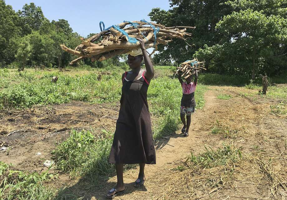 A woman and her daughter carry firewood near Juba. Deforestation contributes to climate change. Photo: Sam Mednick, Associated Press