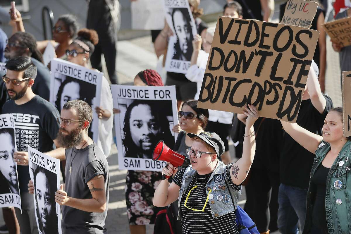 Protesters chant as they march during a demonstration on the University of Cincinnati campus demanding that a white former police officer be tried a third time in the fatal shooting of an unarmed black motorist, Wednesday, June 28, 2017, in Cincinnati. A mistrial was declared twice in the murder and voluntary manslaughter case of Ray Tensing, a former University of Cincinnati police officer, who shot Sam DuBose during a 2015 traffic stop. (AP Photo/John Minchillo)