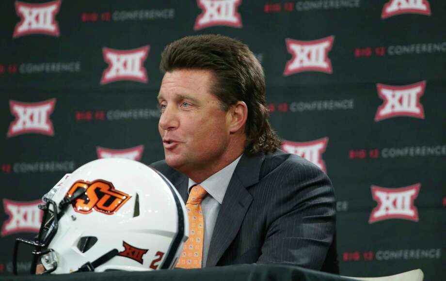 PHOTOS: A look at Mike Gundy's glorious mulletOklahoma State head football coach Mike Gundy speaks to reporters during the Big 12 NCAA college football media day in Frisco, Texas, Tuesday, July 18, 2017. (AP Photo/LM Otero)Browse through the photos above for more looks at Mike Gundy's mullet. Photo: LM Otero, Associated Press / Copyright 2017 The Associated Press. All rights reserved.