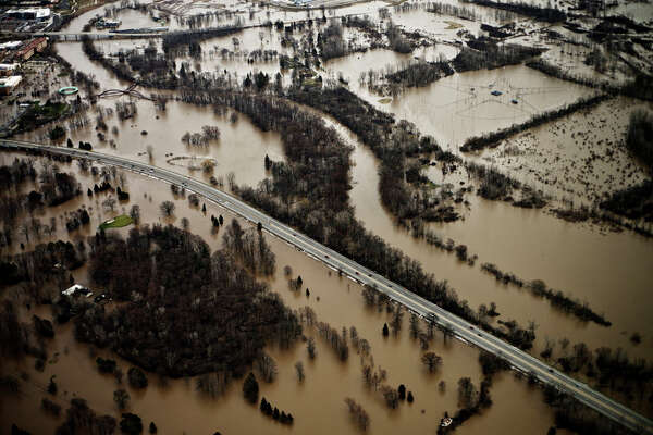 •There's at least $100,000 in damage at Currie Golf Course. The east clubhouse was full of water and an equipment storage area flooded.  (This aerial view of the Tittabawassee River flooding shows Currie Golf Course, M-20 and parts of downtown Midland in an April 2014 file photo.)
