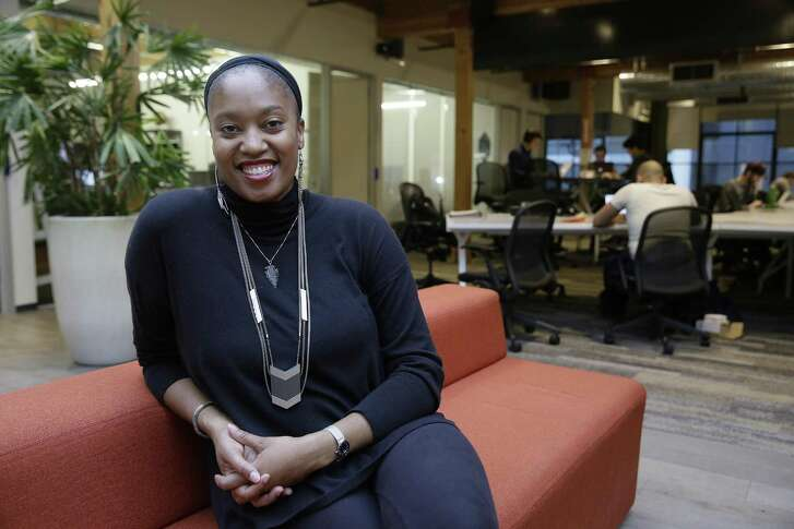 Aniyia Williams, founder and CEO of Tinsel, poses at the offices of Galvanize in San Francisco. Williams says she has made sure to hire women as well as underrepresented minorities. Tinsel makes tech jewelry targeted at women.