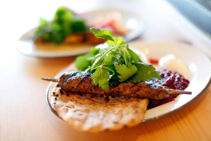 Lamb plate with flatbread, mashed beets and cucumbers at Kebabery in Oakland, Calif. on Monday, July 17, 2017.