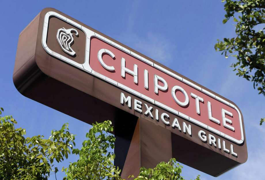 The familiar sign of a Chipotle restaurant can be seen in Hialeah, Fla. Chipotle's stock plunged nearly 8 percent on Tuesday, erasing its gain for the year. Photo: Associated Press File Photo / AP