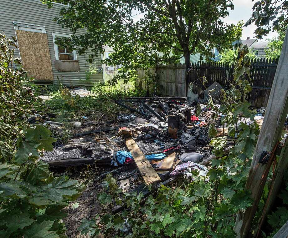 Exterior view of the rear yard and the burned shed of 61 Sixth Avenue where a sixth suspicious fire in two weeks occurred Tuesday July 18, 2017 in Troy, N.Y.   (Skip Dickstein/Times Union) Photo: SKIP DICKSTEIN, Albany Times Union / 20041072A