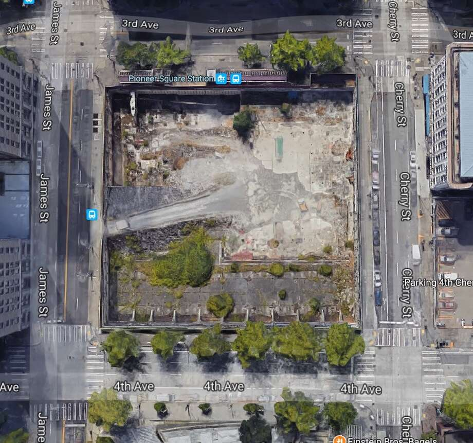 This image, from Google Earth, shows the hole in the ground across the street from City Hall that is, under a new deal sent to City Council Tuesday, set to finally be developed starting in 2019. Photo: Google Earth