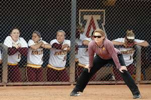 FILE - In this May 15, 2015, file photo, Minnesota head coach Jessica Allister watches the action in the first inning of an NCAA college softball game against New Mexico State in Tucson, Ariz. Allister, who steered the Gophers to a 56-5 record and top national ranking this year, is leaving for Stanford. The University of Minnesota announced Allister's move back to her alma mater on Tuesday, July 18 2017. (AP Photo/Rick Scuteri, File)
