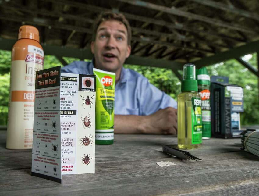 Bryon Backenson, deputy director, Bureau of Communicable Disease Control, DOH speaks about tick protective methods as tick surveillance team members drag for ticks for sampling at Veteran's Memorial Park after a second confirmed case of potentially deadly powassan virus has been diagnosed in the area Tuesday July 18, 2017 in Ballston Lake, N.Y. (Skip Dickstein/Times Union)